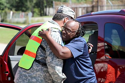 Captain Dwayne Sheridan hugs a lady whom he just helped during the hurricane.