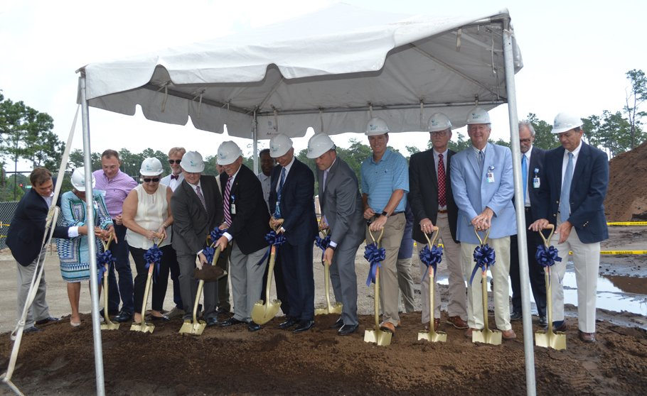 Members of Tidelands Health board and administration break ground on The Market Common site.