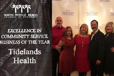 A picture of Tidelands team members accepting an award