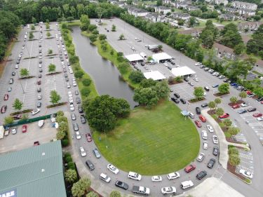 Drone photo of vehicles lined up at Myrtle Beach Pelicans Stadium during a free community COVID-19 testing event.