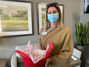 Laura Cason, marketing director at Inlet Coastal Resort, drops off a basket of Valentine's Day cards for patients at Tidelands Health.