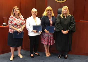 Phyllis Watford, second from left, after being sworn in as a volunteer guardian ad litem.