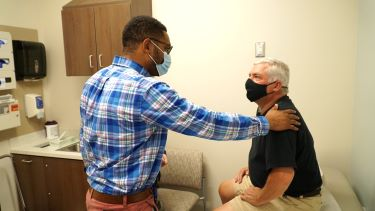 Dr. Darwin McKnight talks with a patient at Tidelands Health Medical Park at The Market Common