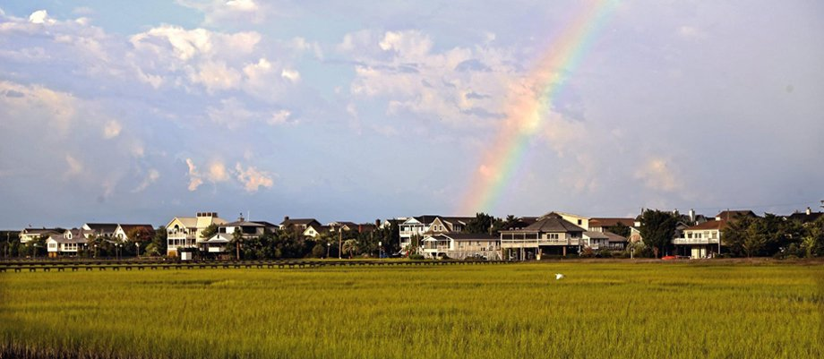 A rainbow lands down on the town of Pawleys Island.