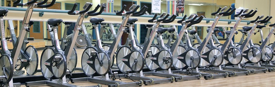 Excrcise bicycles lined up in a row.