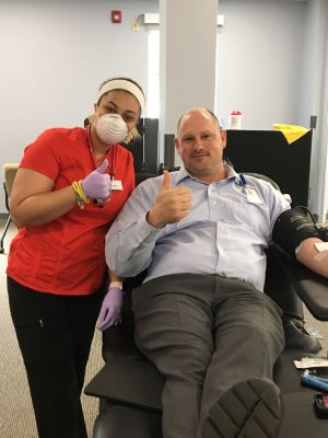 Adam Mattox of Tidelands Health donates blood during a blood drive earlier this year.