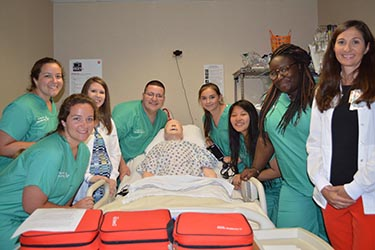 Nurses and students together in the simulation lab