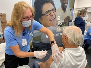 Thomas Leonard of Murrells Inlet receives a shot - his second dose of the COVID-19 vaccine.