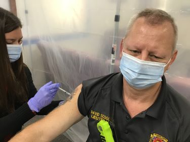 Stella Johnson, employee health coordinator at Tidelands Health, administers the COVID-19 vaccine to Lt. David Scoggins with Georgetown County Fire/EMS on Tuesday at Tidelands Georgetown Memorial Hospital.