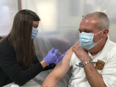 Stella Johnson, employee health coordinator at Tidelands Health, administers the COVID-19 vaccine to Tony Hucks, assistant fire chief at Georgetown County Fire/EMS, on Tuesday at Tidelands Georgetown Memorial Hospital.