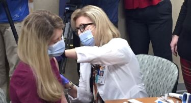 Nurse Ashley Griffith gets the COVID-19 vaccine Dec. 16.