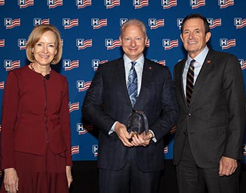 Tidelands Health President and CEO Bruce Bailey receives AHA award.