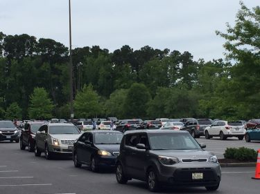 Vehicles lines up for COVID-19 testing at Pelicans stadium
