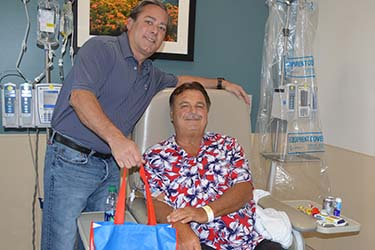 A gift bag is presented to Tidelands Health cancer patient Ronald Breno