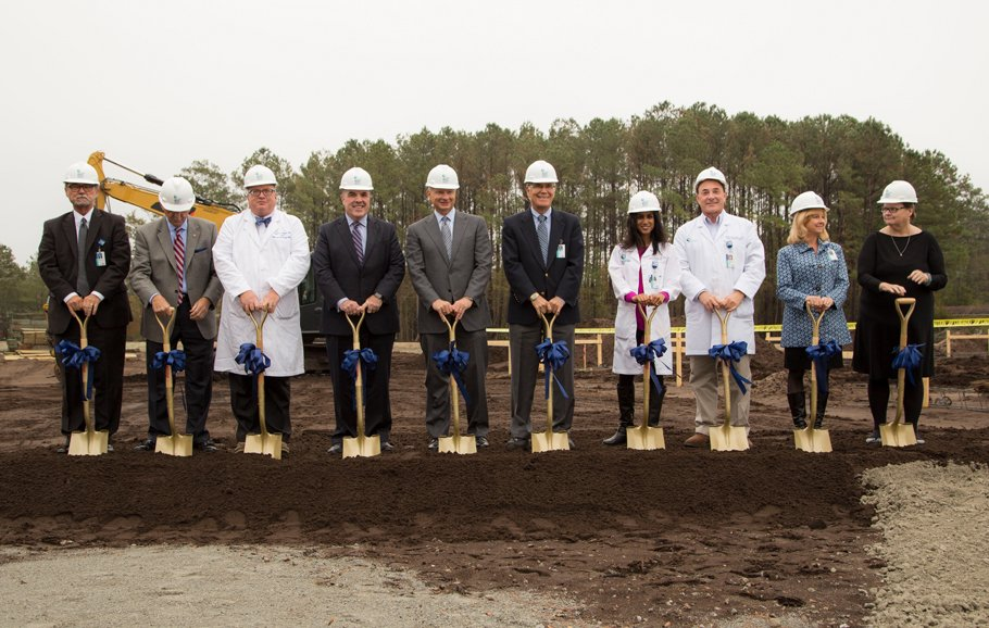 A group from both Tidelands Health and MUSC break ground at the new location.